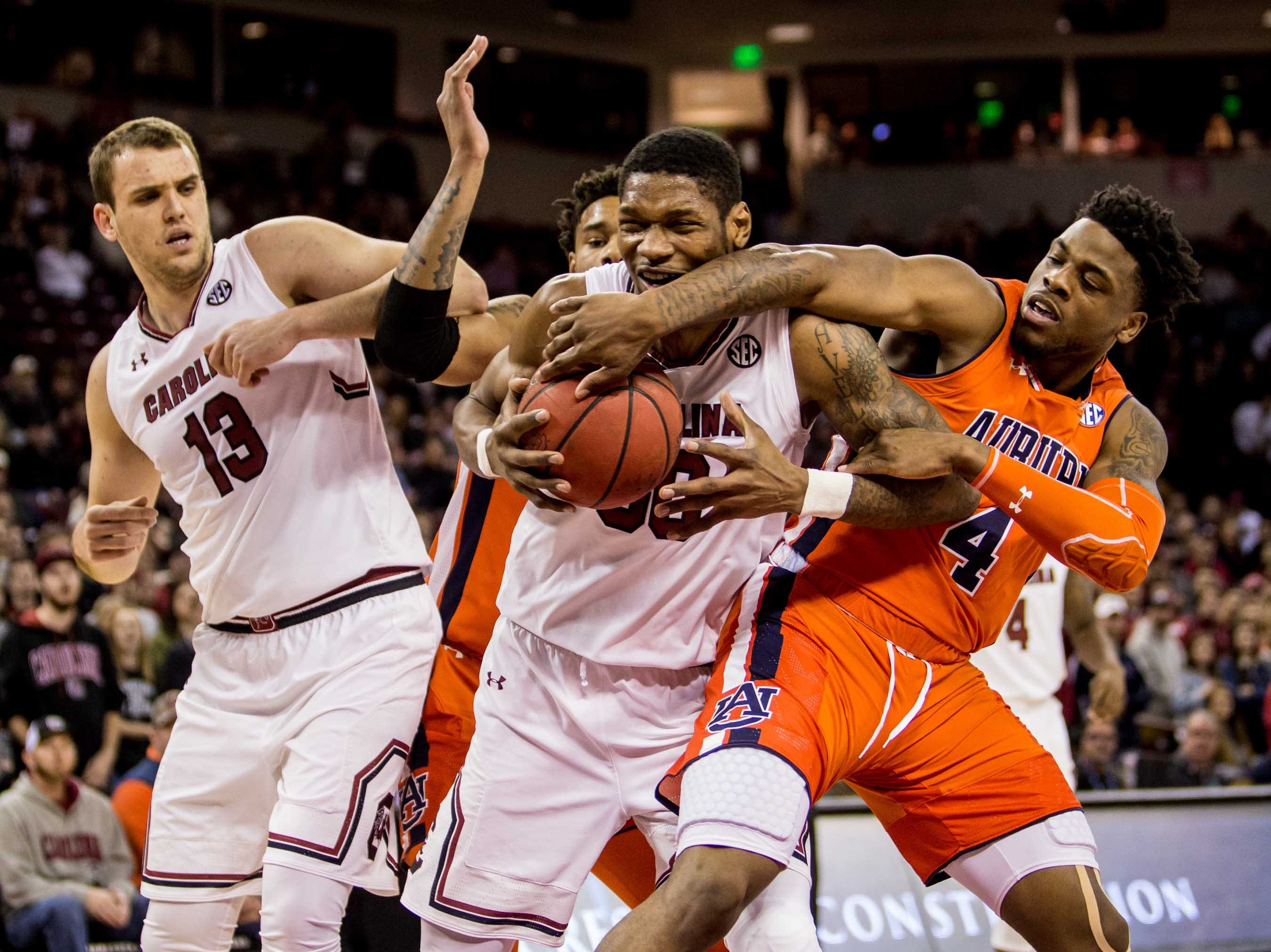 Jan 22, 2019; Columbia, SC, USA; South Carolina Gamecocks forward Chris Silva (30) is fouled by Auburn Tigers guard Malik Dunbar (4) in the first half at Colonial Life Arena. Mandatory Credit: Jeff Blake-USA TODAY Sports