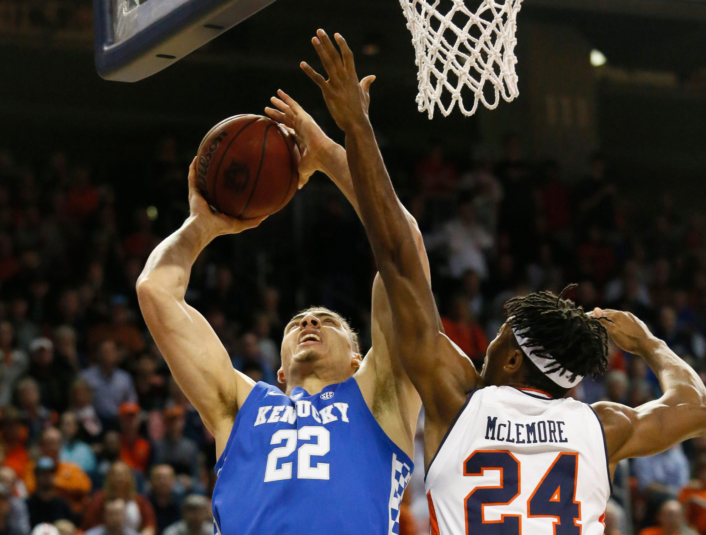 Jan 19, 2019; Auburn, AL, USA; Kentucky Wildcats forward Reid Travis (22) takes a shot against Auburn Tigers forward Anfernee McLemore (25) during the first half at Auburn Arena. Mandatory Credit: John Reed-USA TODAY Sports