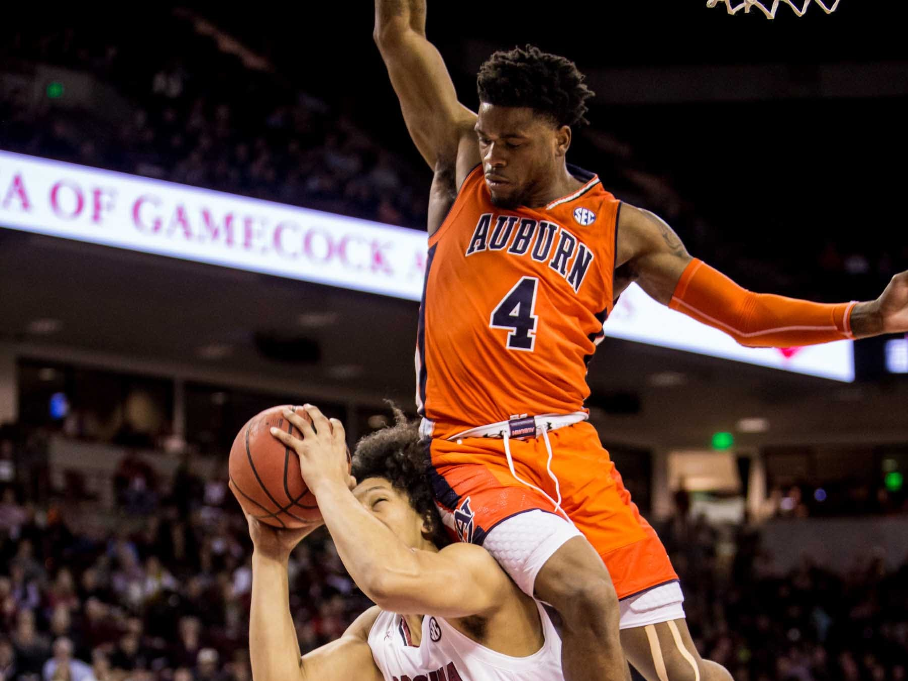 Jan 22, 2019; Columbia, SC, USA; South Carolina Gamecocks forward Alanzo Frink (20) is fouled by Auburn Tigers guard Malik Dunbar (4) in the first half at Colonial Life Arena. Mandatory Credit: Jeff Blake-USA TODAY Sports