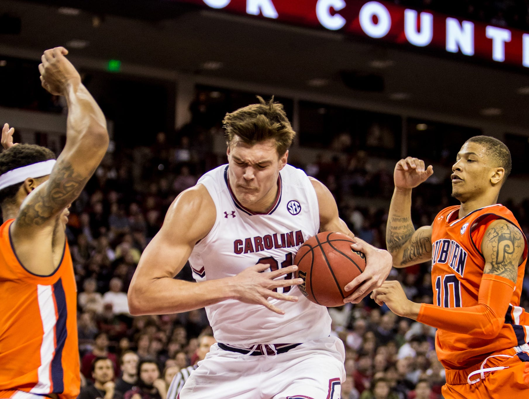 Jan 22, 2019; Columbia, SC, USA; South Carolina Gamecocks forward Maik Kotsar (21) grabs a rebound against the Auburn Tigers in the second half at Colonial Life Arena. South Carolina won 80-77. Mandatory Credit: Jeff Blake-USA TODAY Sports