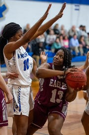 Alabama Christian's Mary Hall (13) is defended by Catholic's Lorren Pharrams (10) on the Montgomery Catholic campus in Montgomery, Ala., on Tuesday January 22, 2019.