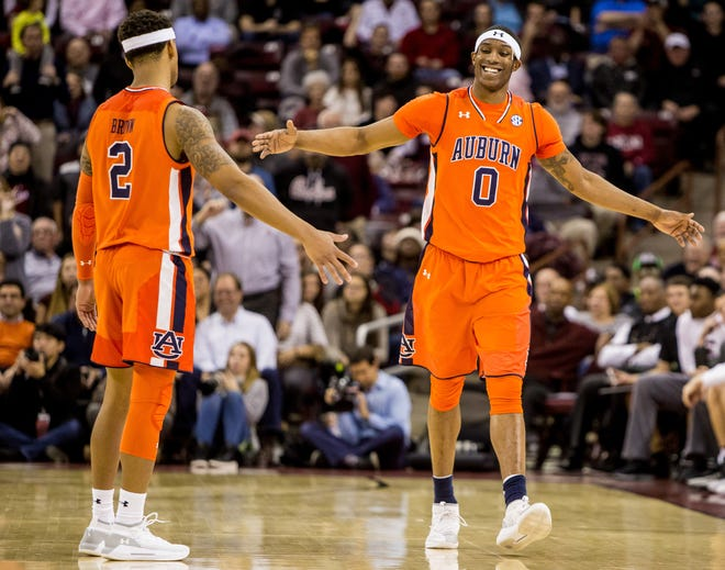 Auburn forward Horace Spencer (0) high-fives guard Bryce Brown (2) during a game at South Carolina on Jan. 22, 2019, in Columbia, S.C.