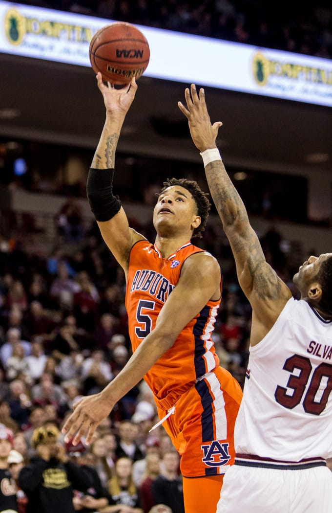 Jan 22, 2019; Columbia, SC, USA; Auburn Tigers forward Chuma Okeke (5) shoots over South Carolina Gamecocks forward Chris Silva (30) in the second half at Colonial Life Arena. South Carolina won 80-77. Mandatory Credit: Jeff Blake-USA TODAY Sports