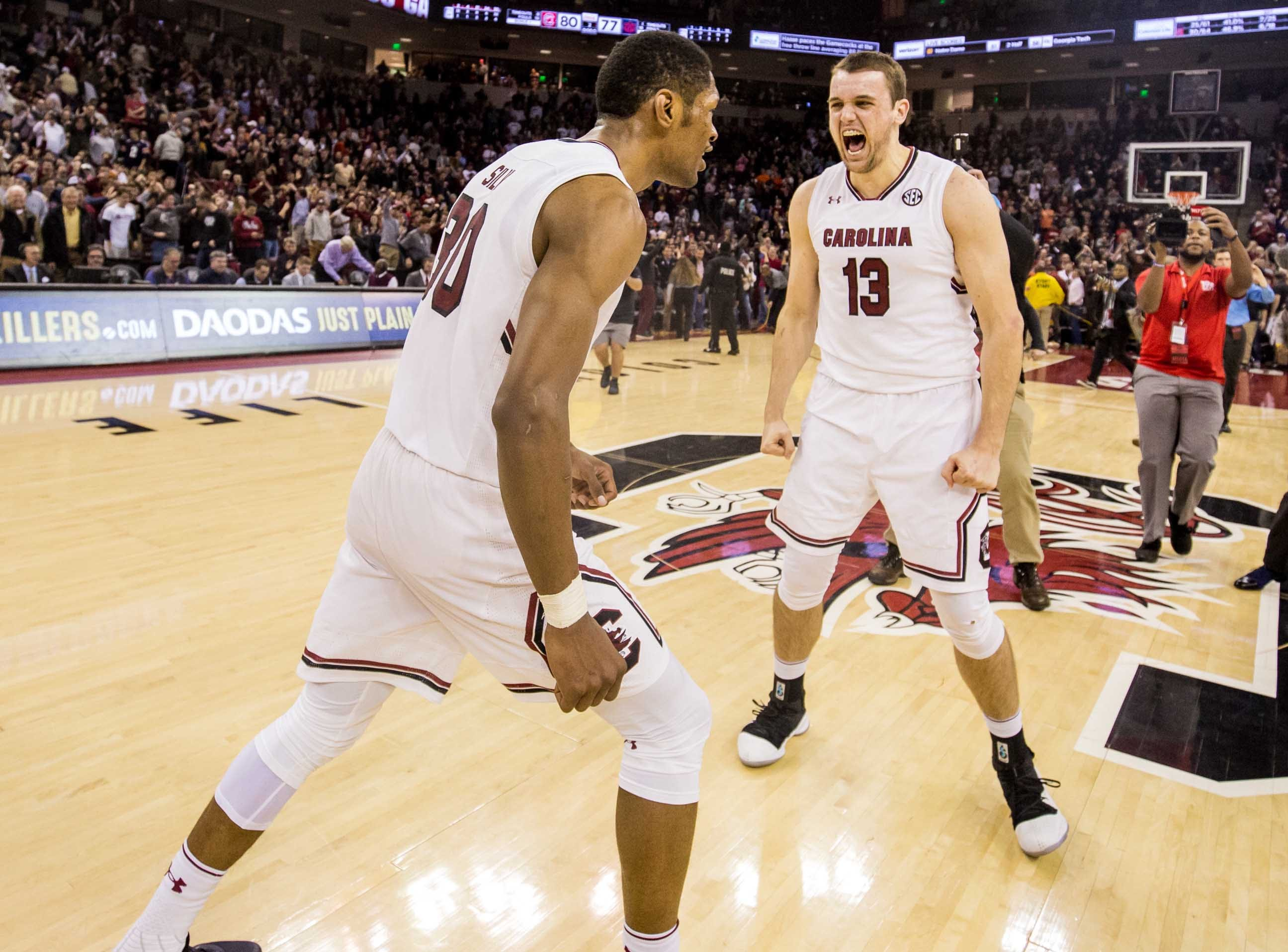 Jan 22, 2019; Columbia, SC, USA; South Carolina Gamecocks forward Chris Silva (30) and South Carolina Gamecocks forward Felipe Haase (13) celebrate following the South Carolina Gamecocks 80-77 win over the Auburn Tigers at Colonial Life Arena. Mandatory Credit: Jeff Blake-USA TODAY Sports