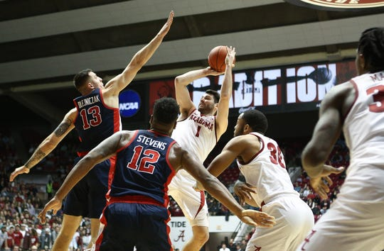 Jan 22, 2019; Tuscaloosa, AL, USA; Alabama Crimson Tide guard Riley Norris (1) shoots against Mississippi Rebels center Dominik Olejniczak (13) during the second half at Coleman Coliseum. Mandatory Credit: Marvin Gentry-USA TODAY Sports