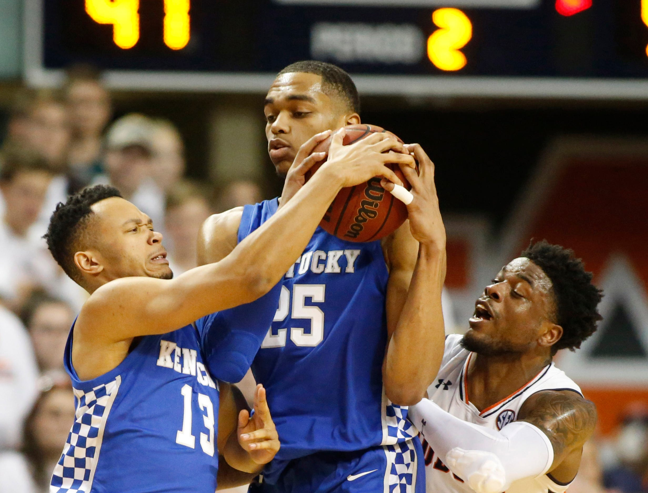 Jan 19, 2019; Auburn, AL, USA;  Kentucky Wildcats forward PJ Washington (25), guard Jermarl Baker (13) and Auburn Tigers guard Malik Dunbar (4) go for the ball during the second half at Auburn Arena. Mandatory Credit: John Reed-USA TODAY Sports