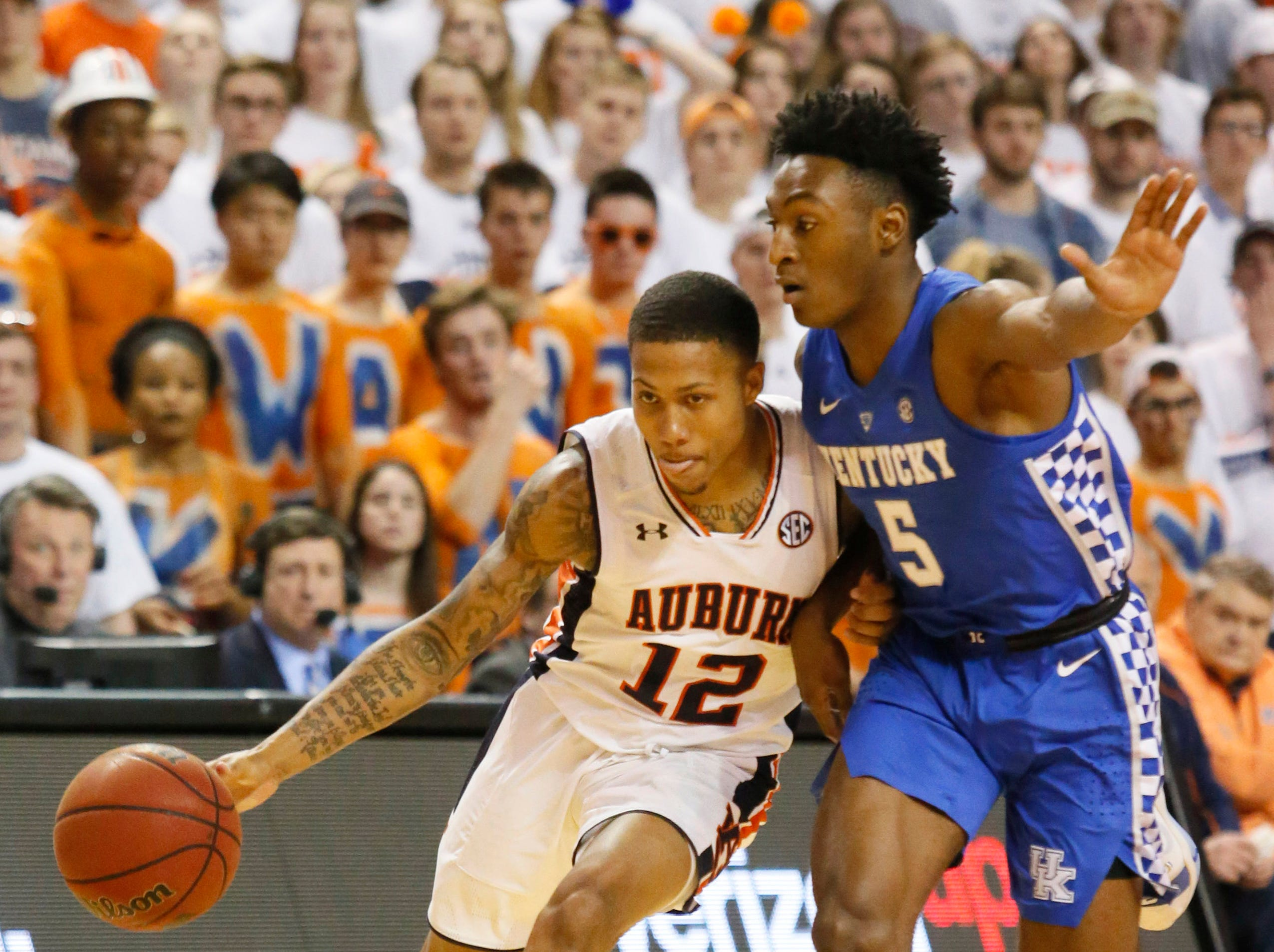 Jan 19, 2019; Auburn, AL, USA;  Kentucky Wildcats guard Immanuel Quiclkey (5) pressures Auburn Tigers guard J'Von McCormick (12) during the second half at Auburn Arena. Mandatory Credit: John Reed-USA TODAY Sports