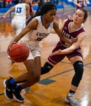 Catholic's Lorren Pharrams (10) is defended by Alabama Christian's Lindsey Glass (4) on the Montgomery Catholic campus in Montgomery, Ala., on Tuesday January 22, 2019.