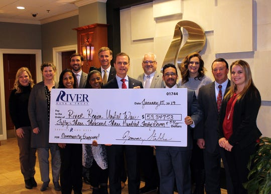 River Bank & Trust employees present a donation to the River Region United Way as part of RRUW's 2018 campaign.