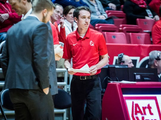 Ball State basketball manager Jason Smith works during the game against Miami at Worthen Arena Tuesday, Jan. 22, 2018.