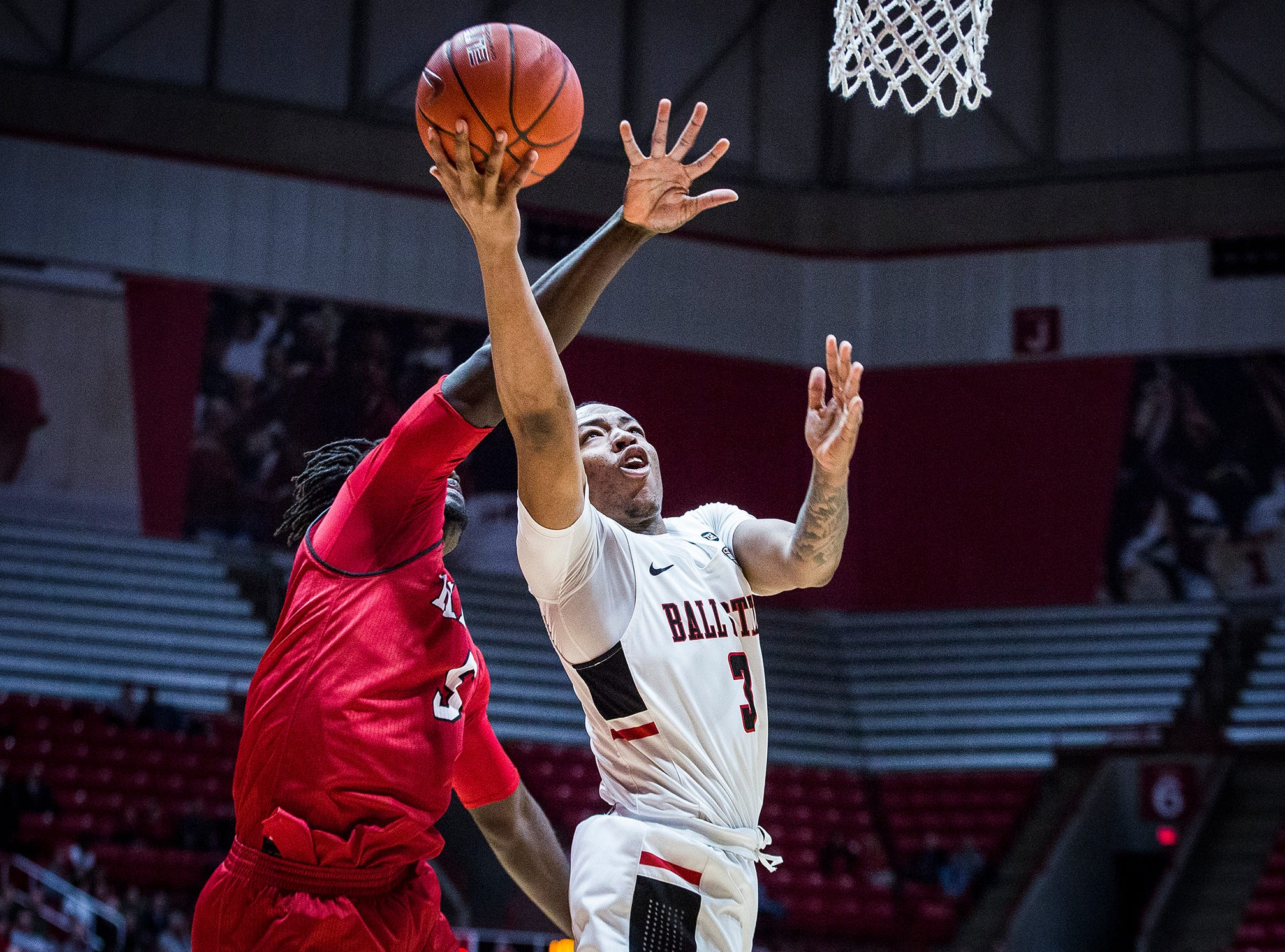 Ball State's Josh Thompson shoots past Miami's defense during their game at Worthen Arena Tuesday, Jan. 22, 2018.