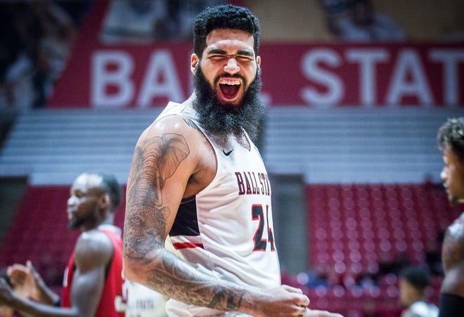Trey Moses, shown here celebrating during a game against Miami on Jan. 22, scored 22 points as Ball State won at Northern Illinois to snap a four-game losing streak.