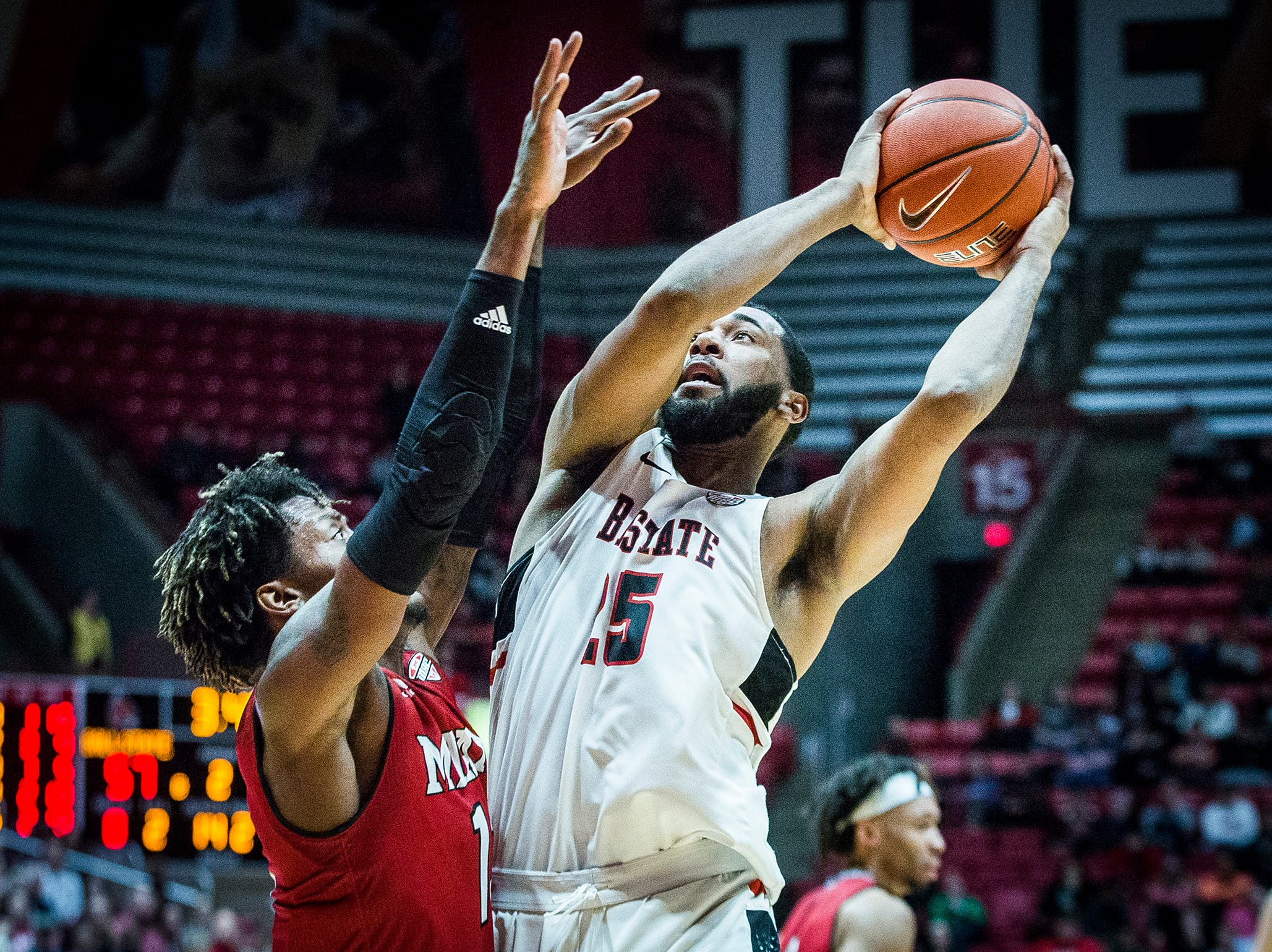 Ball State's Tahjai Teague shoots past Miami's defense during their game at Worthen Arena Tuesday, Jan. 22, 2018.