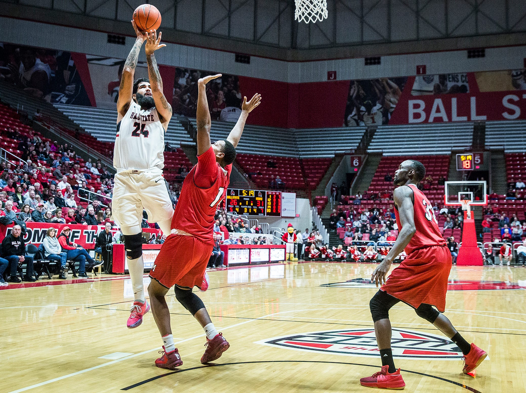 Ball State's Trey Moses shoots past Miami's defense during their game at Worthen Arena Tuesday, Jan. 22, 2018.
