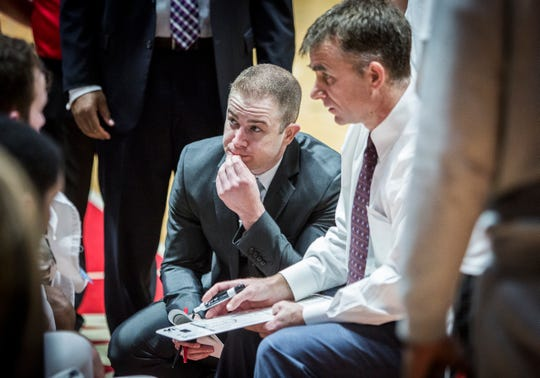 Ball State graduate manager Winston Yergler looks on during a huddle at Worthen Arena.