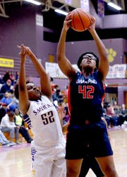 Oakland's Nicole Egeruoh (42) grabs a rebound as Smyrna's Audrey Hampton (52) also goes for the rebound on Tuesday Jan. 22, 2019.