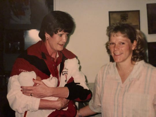Former UT Lady Vol coach Pat Summitt holds MTSU guard Katie Collier when Collier was first born as Shelley Collier, smiles in the photo.