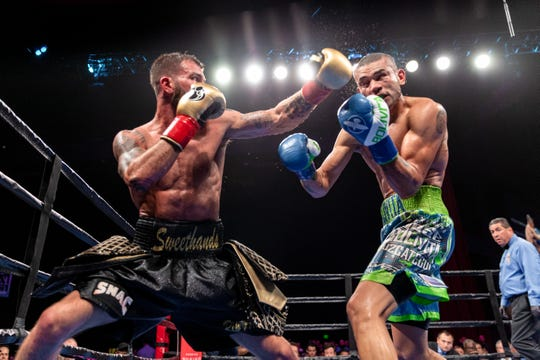 Nashville native Caleb Plant (left) lands a left hook on Jose Uzcategui. Plant won the IBF super middleweight championship by unanimous decision Jan. 13 in Los Angeles.