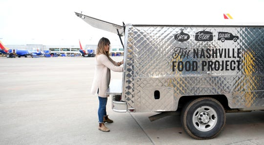 Christa Bentley of the Nashville Food Project helps deliver meals to TSA workers at the Nashville International Airport on Wednesday, Jan. 23, 2019.