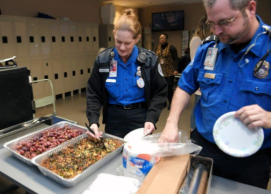 TSA officers Kim Eldridge and Chris Owings pick up breakfast donated and delivered by the Nashville Food Project at the Nashville International Airport on Wednesday, Jan. 23, 2019.  The Nashville Food Pantry plans to deliver food to TSA workers the whole week.