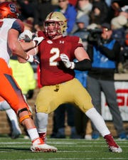 Boston College defensive end Zach Allen (2) tries to evade a block against Syracuse last season.