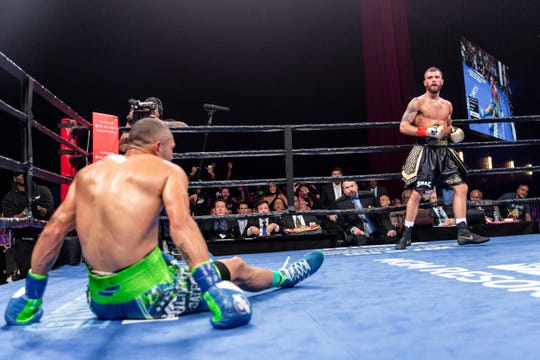 Nashville native Caleb Plant (right) knocked down Jose Uzcategui twice on the way to winning the IBF super middleweight championship on Jan. 13 in Los Angeles.