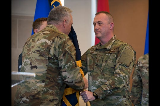 U.S. Air Force Brig. Gen. L. Kip Clark, left, assistant adjutant general, Indiana Air National Guard, presents the colors to U.S. Air Force Command Chief Master Sgt. Michael C. May, right, state command chief, Indiana Air National Guard, during a change of responsibility ceremony Jan. 13, 2019, at the 122nd Fighter Wing, Fort Wayne, Ind. Command Chief May assumed the position in place of outgoing Chief Master Sgt. James E. Salway who served in the position for over five years. (U.S. Air National Guard photo by Tech. Sgt. William Hopper/Released)