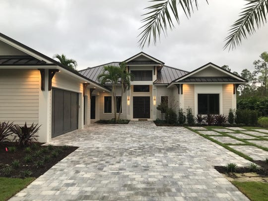 KTS Homes specializes in contemporary custom homes in the gated communities of Naples Club Estates (shown) and Naples Reserve.