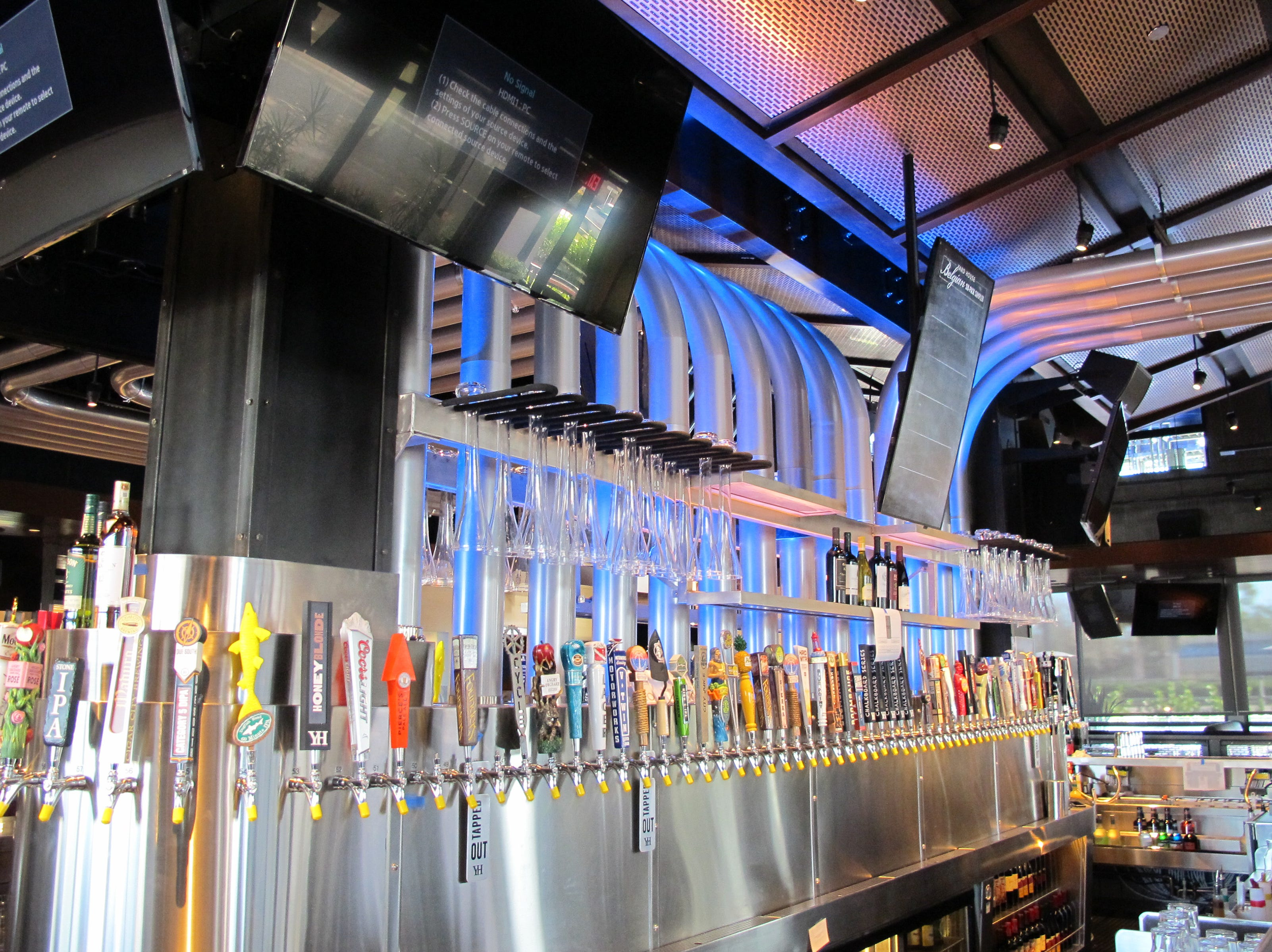 Miles of beer lines connect cold kegs on the second floor to taps at the Yard House bar at Park Shore Plaza in Naples.