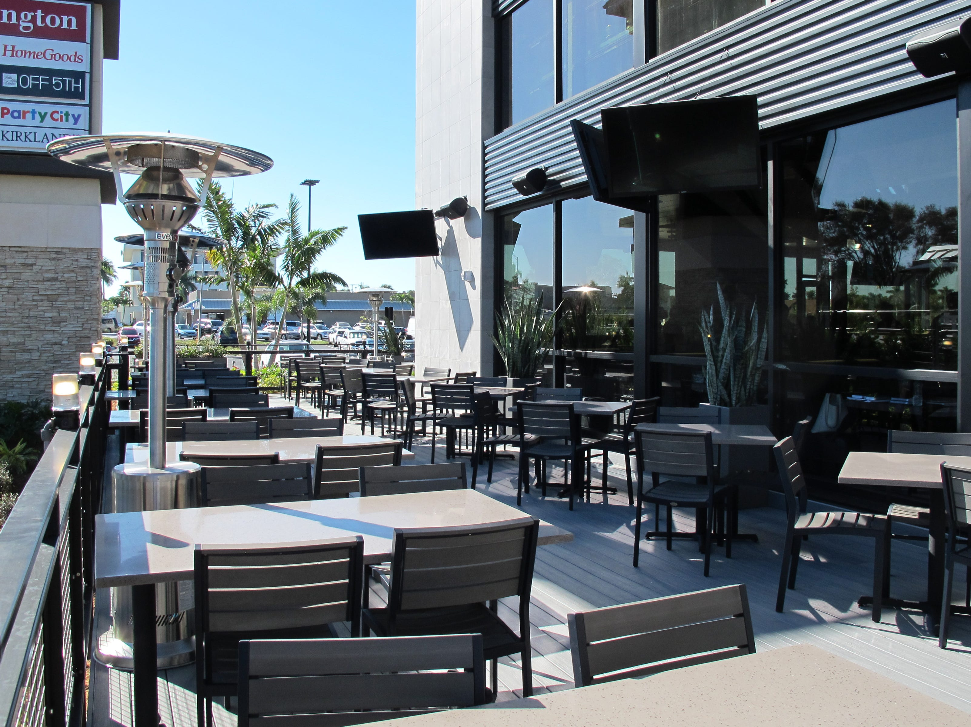 Outdoor patio dining at the new Yard House at Park Shore Plaza in Naples.