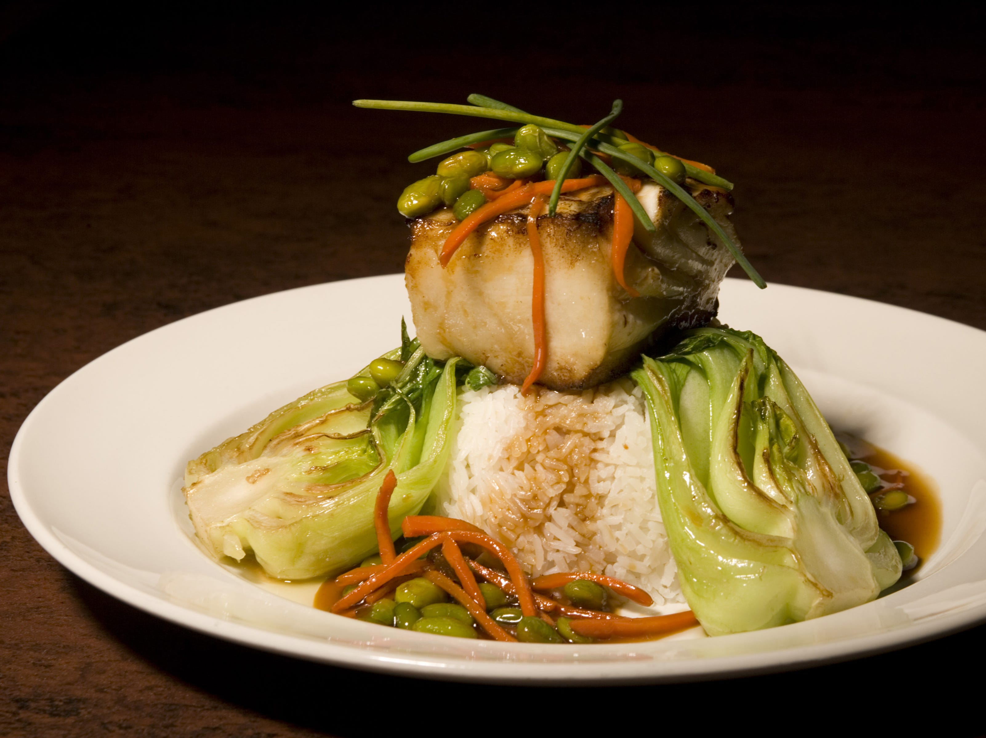 Miso Glazed Sea Bass with bok choy, carrots, edamame and jasmine rice at Yard House.