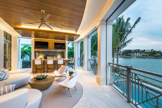 Port Royal estate at 4395 Gordon Drive offers water views and a private boat dock.