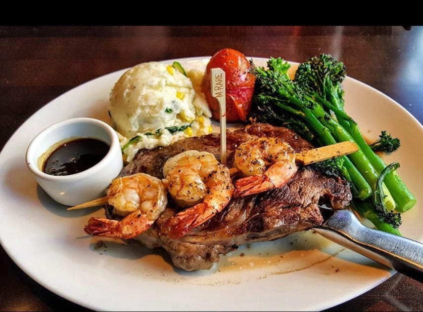 Yard House's Rib Eye & Shrimp features a 12-ounce steak with spinach mashed potatoes, broccolini and house-made steak sauce.