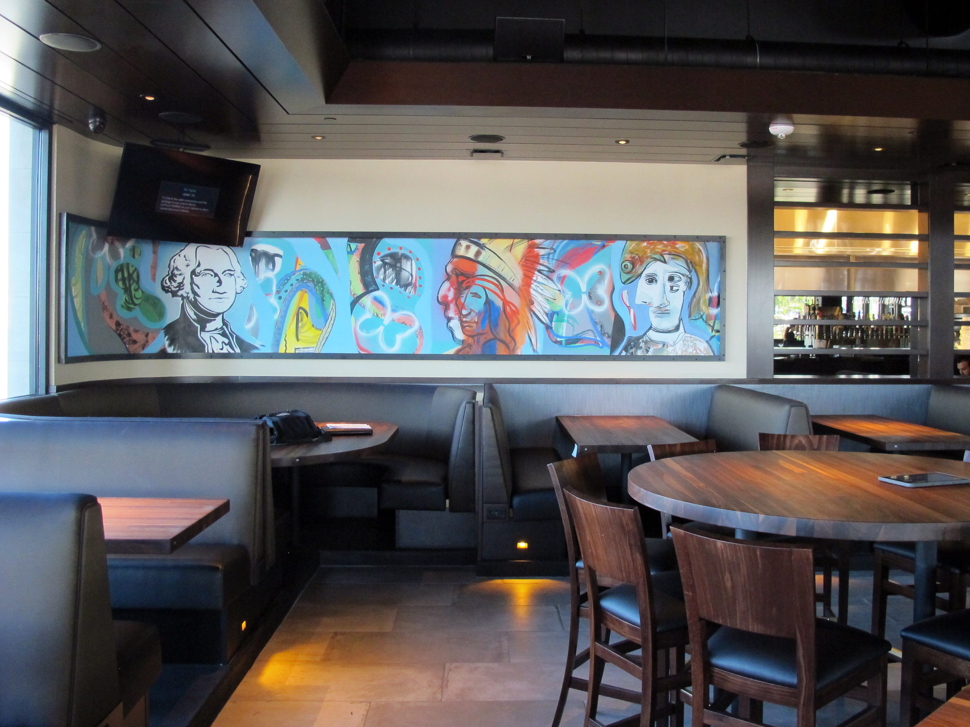 Modern art decorates the dining room at the new Yard House in Naples.