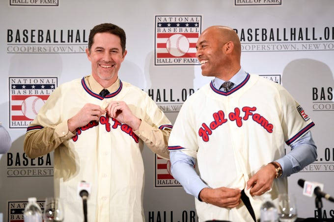 Former New York Yankee pitchers Mike Mussina, left, and Mariano Rivera put on their Hall of Fame jerseys during a press conference on Wednesday, Jan. 23, 2019, in New York.