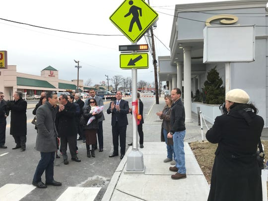 Gerald D'Amico, far right, activates the signal, alerting drivers of a pedestrian crossing on Franklin Avenue in Belleville. His brother, Joseph, died of his injuries after being hit by a car at the same location on Dec. 30, 2017.