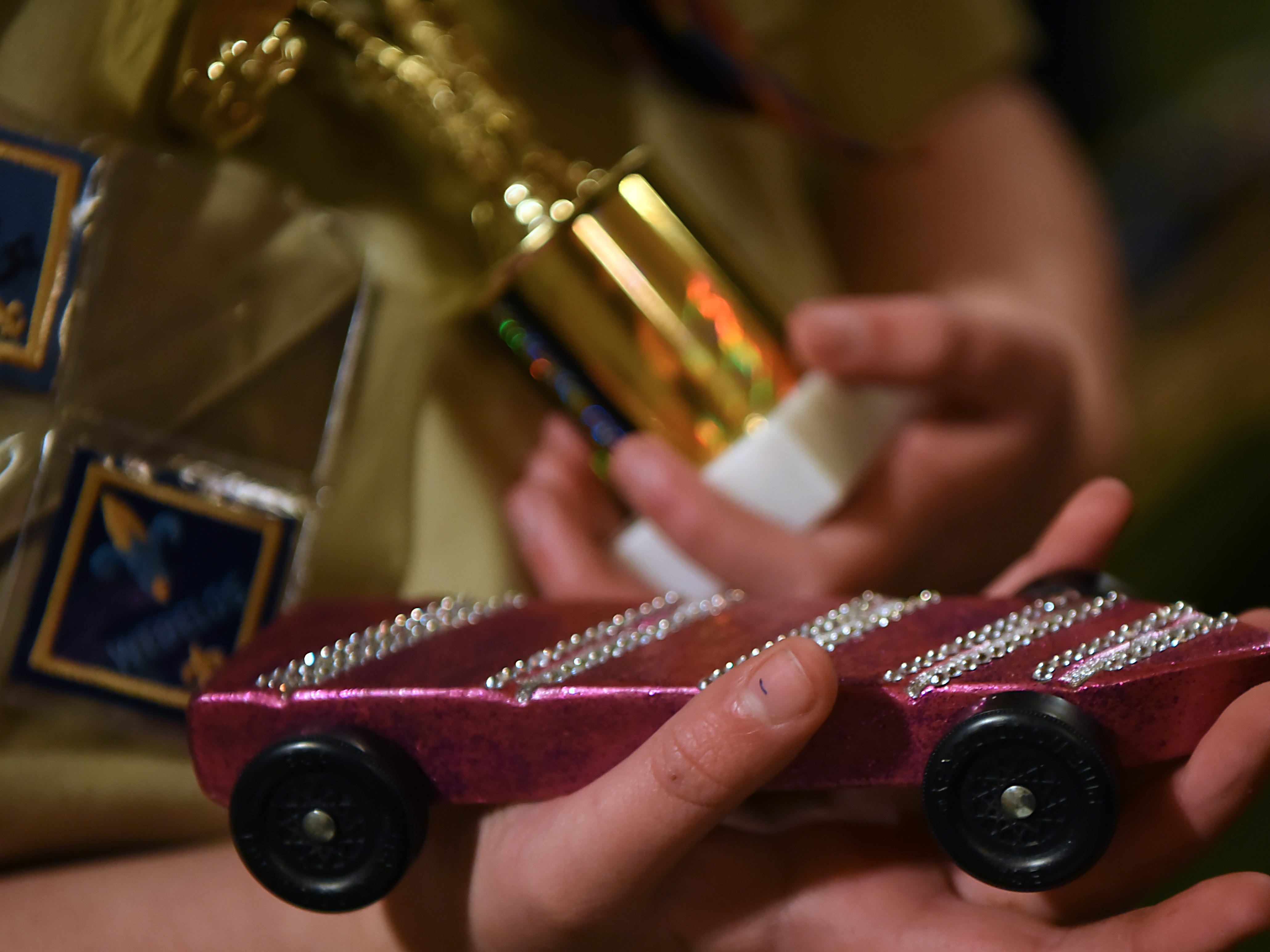 Brenna Johnson, 11 in Cub Scout pack 165 Arrow of Light den, shows off her winning car and trophy during the Morris County Pinewood Derby at Holy Trinity Lutheran Church in Rockaway on Friday January 18, 2019.