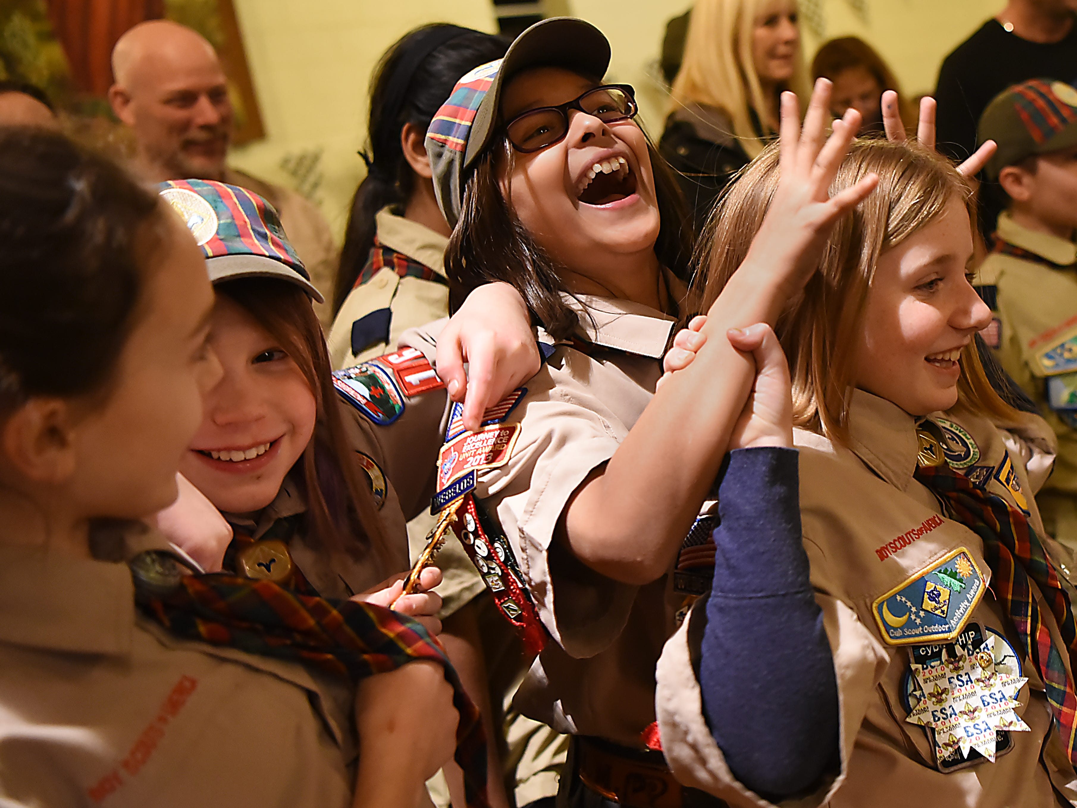 The Morris County Pinewood Derby at Holy Trinity Lutheran Church in Rockaway on Friday January 18, 2019. (From left) Addison Christian, Cameron Wagner, Anika Zoeller and Madison Sipple, all in Cub Scout pack 165 Arrow of Light den, share a laugh.