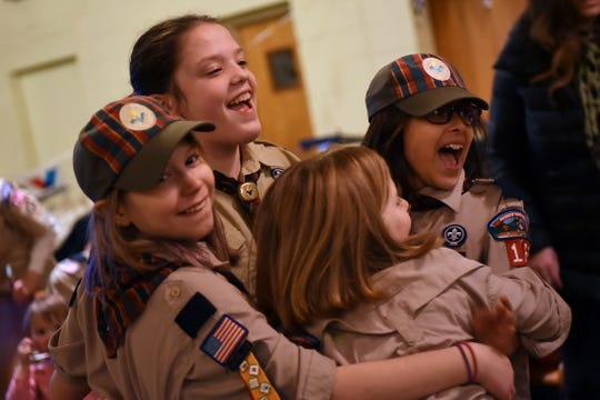 From left, Rockaway Cub Scouts Cameron Wagner, 10, Brenna Johnson, 11, Madison Sipple, 10, and Anika Zoeller, 10, celebrate after Brenna's car made it to the finals at the Pinewood Derby at the Holy Trinity Lutheran Church in Rockaway.