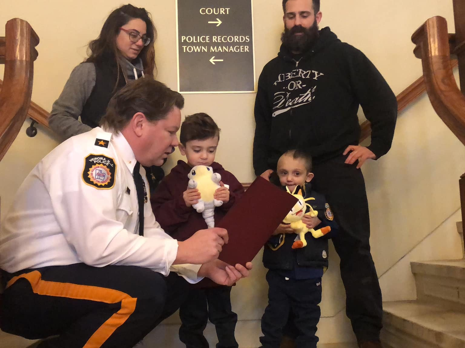 Verona Police Chief Chris Kiernan reads an oath to 4-year-old Micco LaRosa Jan. 20, 2019.