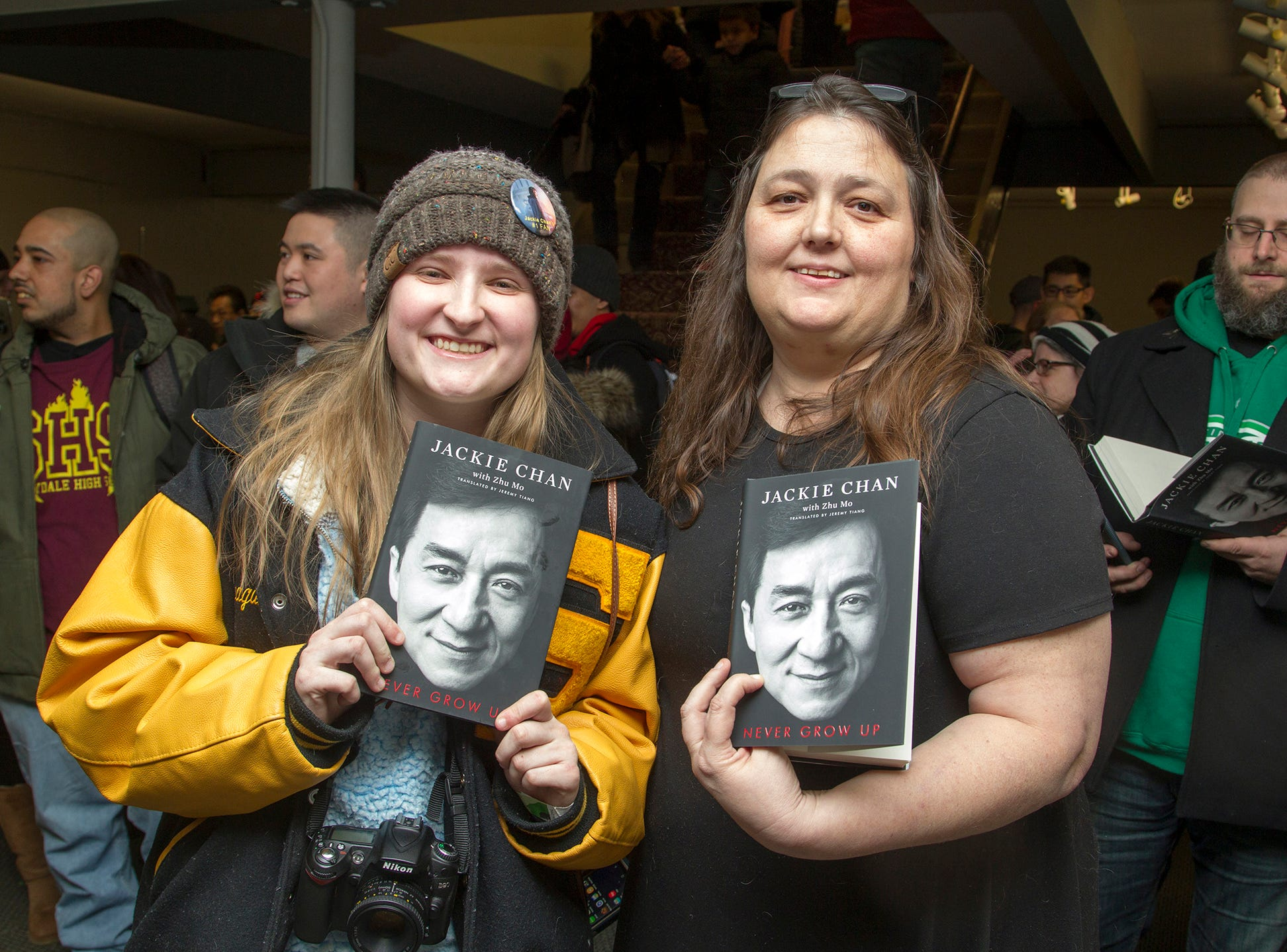 """Camille and Stacy. Jackie Chan greets fans at Bookends in Ridgewood while signing his new book, """"Never Grow Up."""" 01/21/2019"""