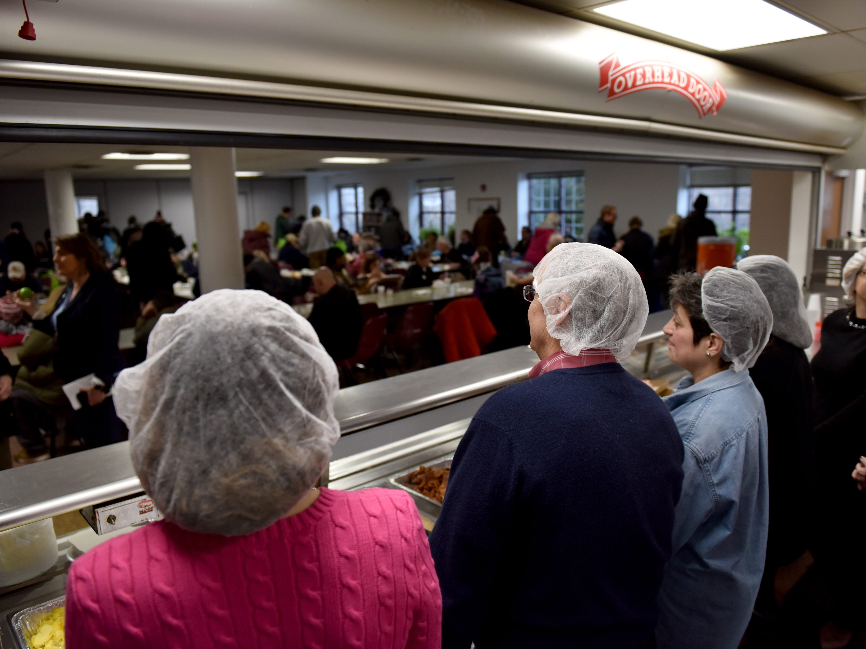 Volunteers serve breakfast to the homeless at the Bergen County Human Services Center in Hackensack, on Wednesday January 23, 2019.