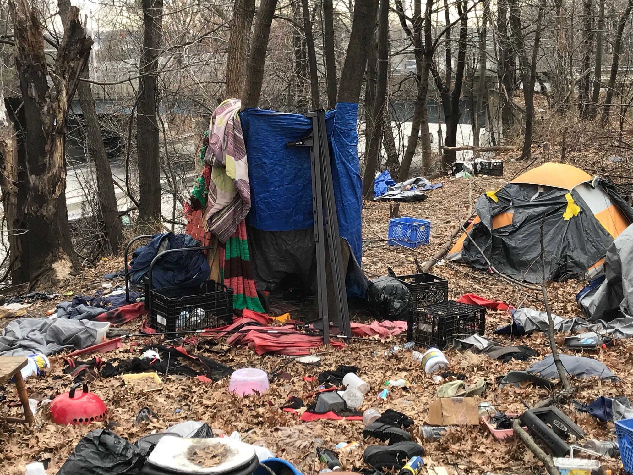 The remains of homeless encampment in city of Passaic between Route 21 and Veteran's Park. The state of NJ owns land and have put in a fence which acts as deterent. There's still one tent there.
