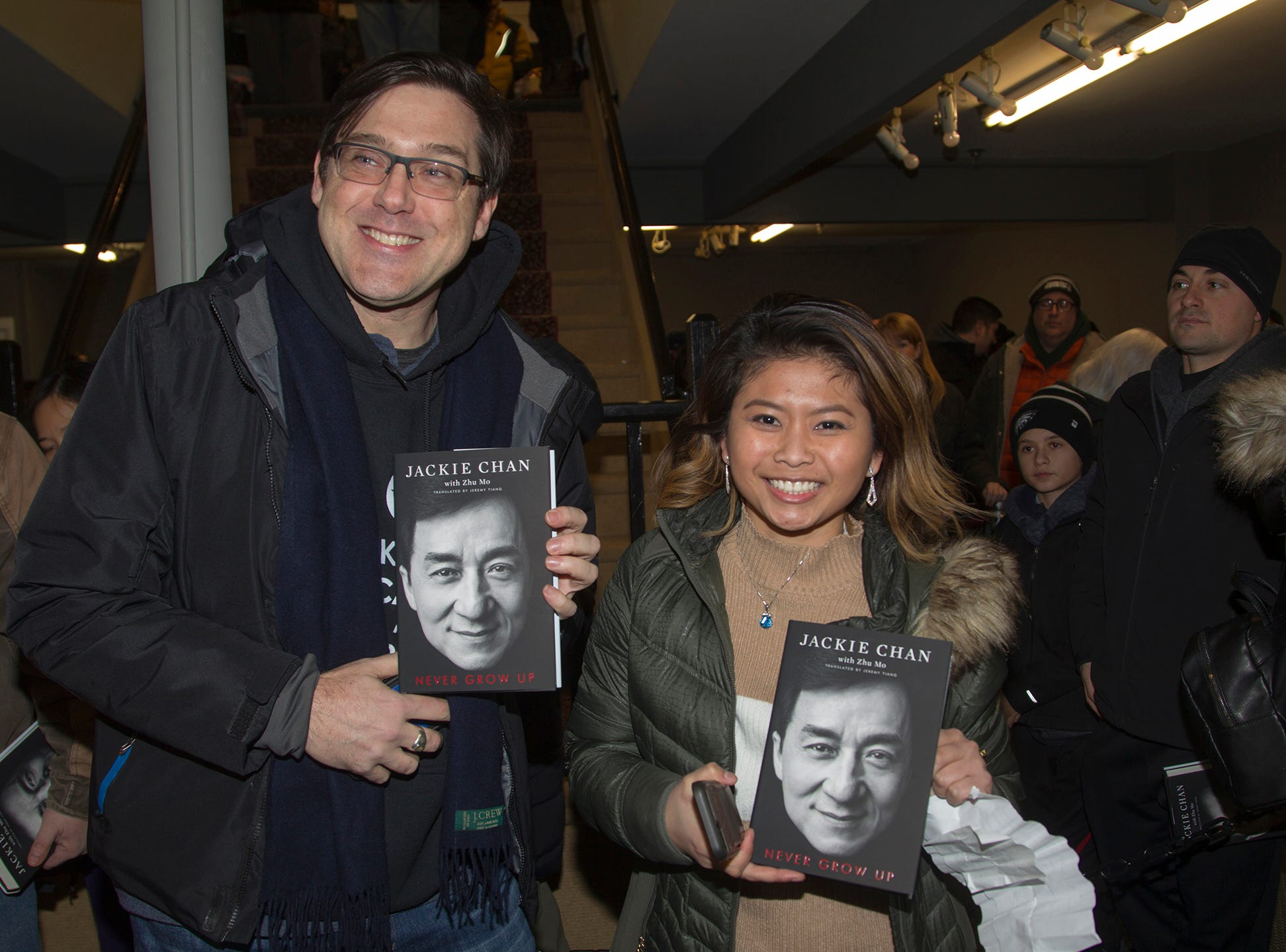 """Phil and Jen. Jackie Chan greets fans at Bookends in Ridgewood while signing his new book, """"Never Grow Up."""" 01/21/2019"""
