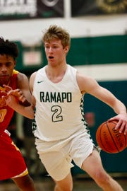 Ramapo's KC Hunt is guarded by Jayson Earle during Bergen Catholic's 65-61 victory in Franklin Lakes on Tuesday, January 22, 2019.