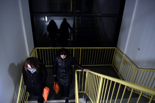 Volunteers check a stairwell for homeless in Bergen Community College late Tuesday night in Paramus. Bergen County's annual Point-in-Time count of the homeless includes the youth population for the first time this year.