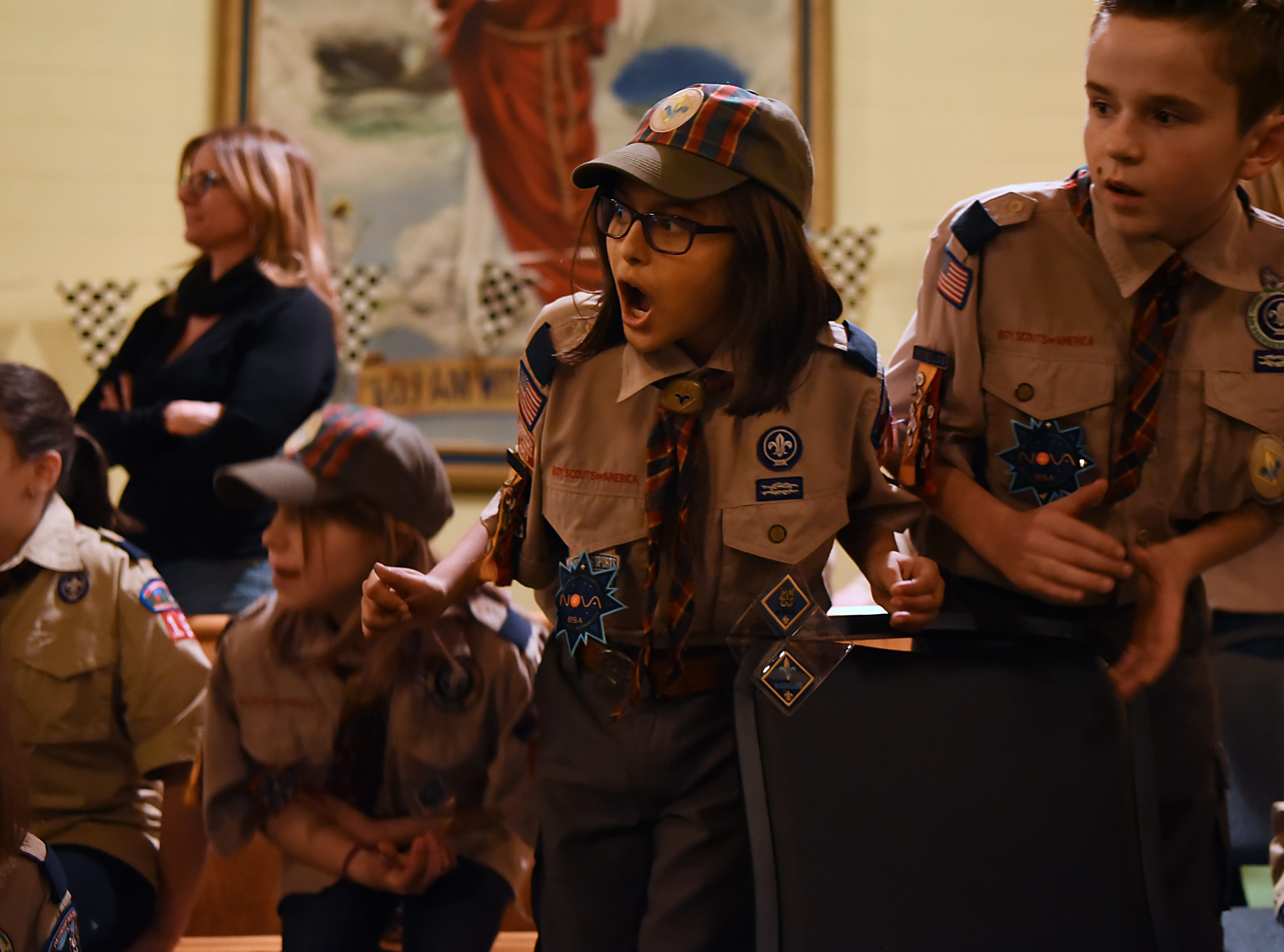 The Morris County Pinewood Derby at Holy Trinity Lutheran Church in Rockaway on Friday January 18, 2019. Anika Zoeller, 10 with Cub Scout pack 165 Arrow of Light den, reacts as the cars race to the finish line.