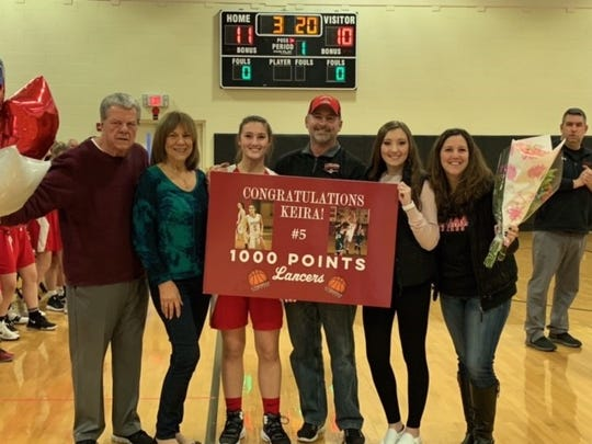 Lakeland junior Keira Marks, center, is surrounded by family after scoring her 1,000th career point last Thursday in a 56-42 win over Bergen Tech.
