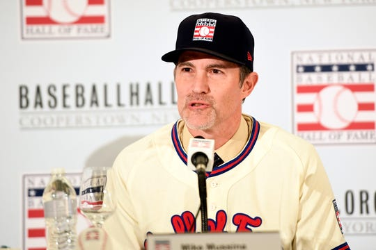 Former New York Yankee pitcher Mike Mussina answers questions during the Hall of Fame press conference on Wednesday, Jan. 23, 2019, in New York.