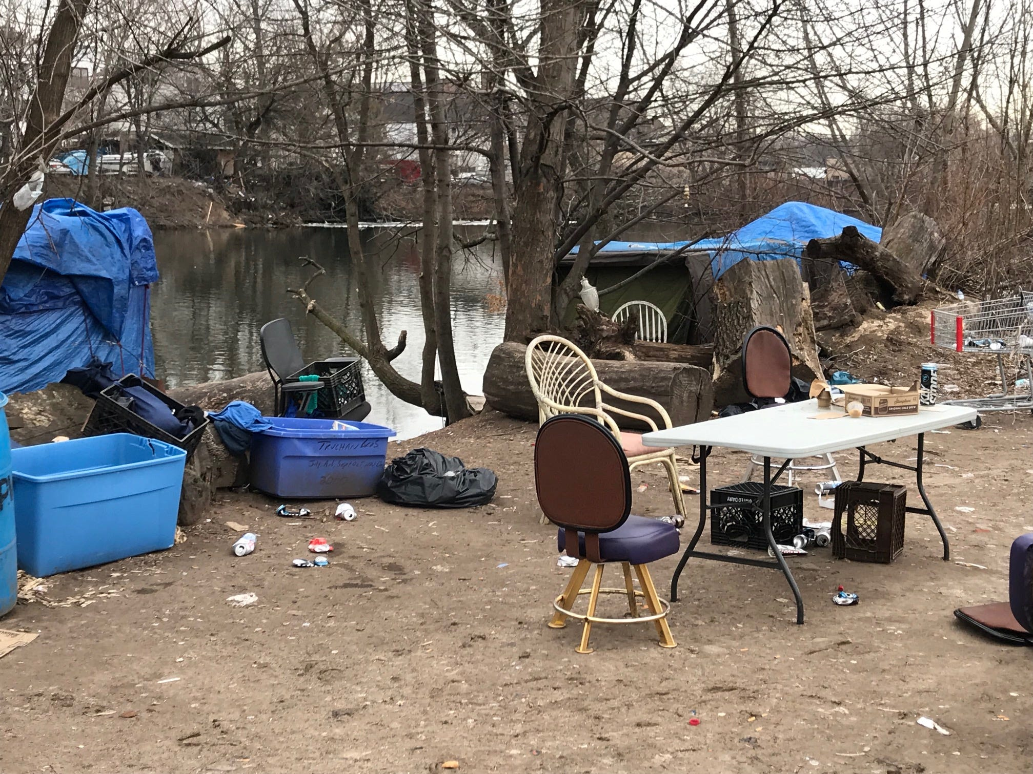 A number of those who frequebnt the Dundee Island encampment took up the City of Passaic's offer to spend Sunday and Monday night in the city's shelter off Aspen Place. The left behind the table and other items where when weather is less harsh they can be found sitting and cokking around.